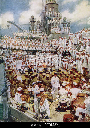 The caption reads: 'Pack up your troubles in your old sea bag. All work and no play was not permitted to make the American sailor a dull boy.' The image dates to 1922 and shows American military on a carrier at sea in World War I. In the foreground a band with a conductor. In the middle is a boxing matched watched by a number of sailors. The others are more sailors and crew watching the events. - Stock Photo