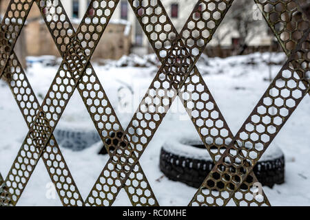 Fence from industrial metal scraps. Close-up photo. - Stock Photo