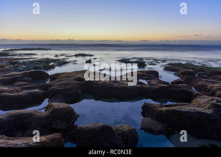 Scenic Panoramic Sunset Landscape of Distant La Jolla Shores and Pacific Ocean from San Diego, California - Stock Photo