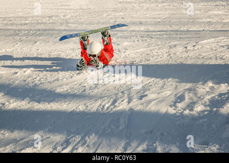 Young girl on a snow, ski report in Canada, she just fall down after he ride down the hill. - Stock Photo