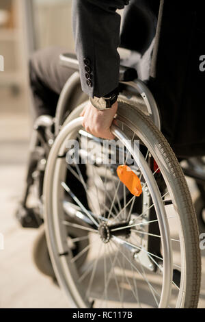 Disabled man in wheelchair - Stock Photo