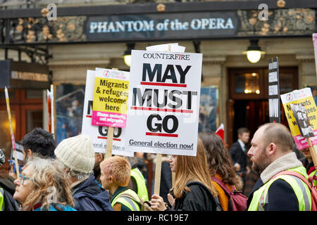 London, UK. 12th Jan, 2019. A protestor with a placard calling for Theresa May to go during the People's Assembly austerity march through London. Credit: Kevin J. Frost/Alamy Live News Credit: Kevin J. Frost/Alamy Live News Credit: Kevin J. Frost/Alamy Live News - Stock Photo