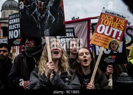 London, UK. 12th January, 2019. People at a protest rally in Trafalgar Square, calling for a general election. The  'Britain is broken' protest was organised by The People's Assembly Against Austerity Credit: Elizabeth Fitt/Alamy Live News - Stock Photo