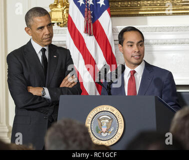Washington, District of Columbia, USA. 23rd May, 2014. United States President Barack Obama, left, announces his nomination of San Antonio Mayor Julián Castro, right, as U.S. Secretary of Housing and Urban Development (HUD) replacing current HUD Secretary Shaun Donovan (not pictured) who has been nominated to be Office of Management and Budget (OMB) Director in the State Dining Room of the White House in Washington, DC on Friday, May 23, 2014 Credit: Ron Sachs/CNP/ZUMA Wire/Alamy Live News - Stock Photo