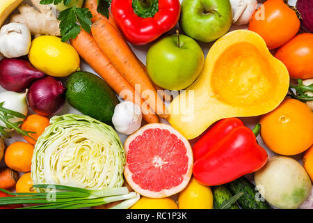 Composition with variety of fresh organic vegetables and fruits, whole and cut, viewed from above in full frame food background concept - Stock Photo