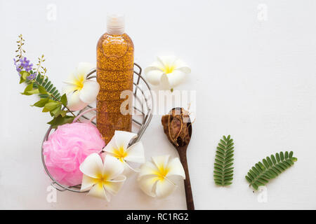 liquid soap exfoliating body wash smooth skin natural extract tamarind health care body skin with flowers frangipani - Stock Photo