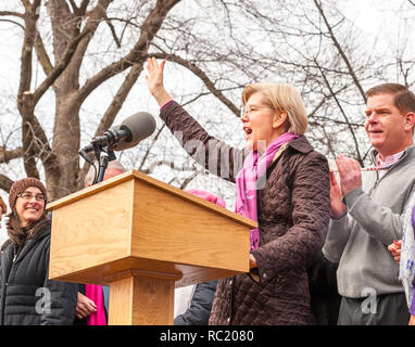 Senator Elizabeth Warren raising her hand and yelling encouragement to the crowd at the Boston Women's March. - Stock Photo
