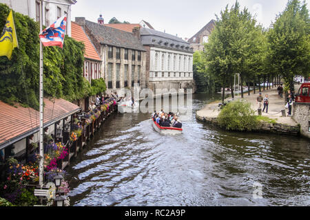 Boat trip in a channel of Brugge, Flanders, Belgium - Stock Photo
