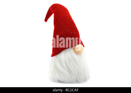 Gnome a Christmas elf wearing big red with glitters hat and standing on white background - Stock Photo
