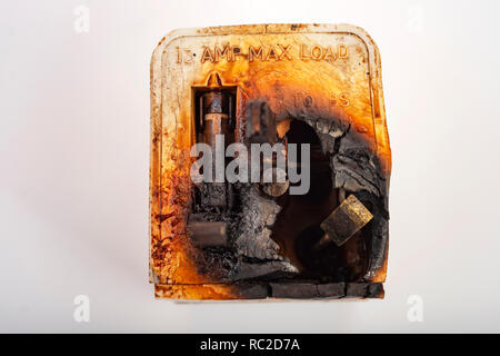 Fire damaged 3-pin plug - Stock Photo