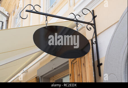 Restaurant street signboard with round edges on modern building wall mockup. - Stock Photo