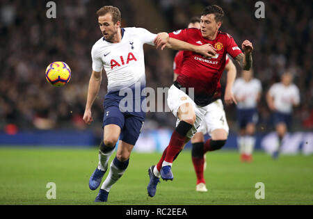 Tottenham Hotspur's Harry Kane (left) and Manchester United's Victor Lindelof battle for the ball during the Premier League match at Wembley Stadium, London. - Stock Photo