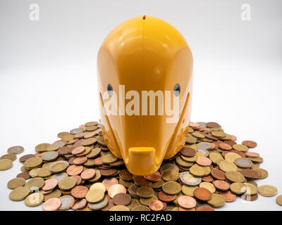 Image of a yellow piggy bank on euro coinswith white background close up - Stock Photo