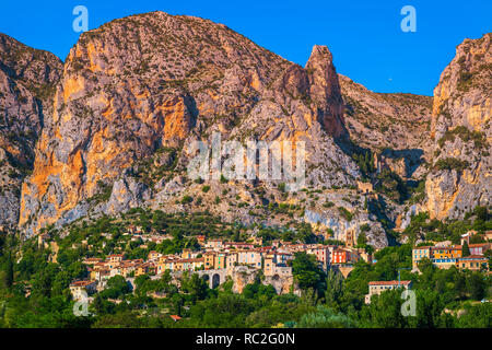 Spectacular touristic place, amazing ancient old city in Provence, Moustiers Sainte Marie, France, Europe - Stock Photo