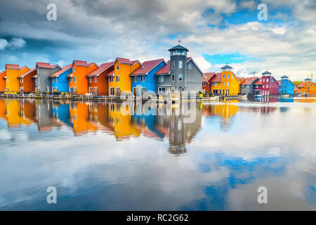 Wonderful touristic Dutch city, famous Reitdiephaven street with traditional colorful modern houses on water, Groningen, Netherlands, Europe - Stock Photo