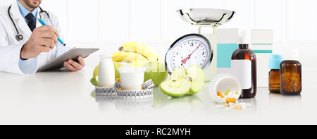 dietitian nutritionist doctor prescribes prescription sitting at the desk office with apple, yogurt, medical drugs, tape meter and scale, healthy and  - Stock Photo