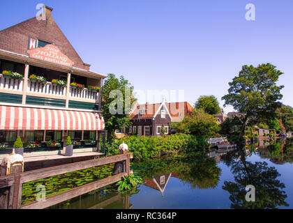 Scene from picturesque cheese-making town of Edam, Holland with historic architecture and canal - Stock Photo
