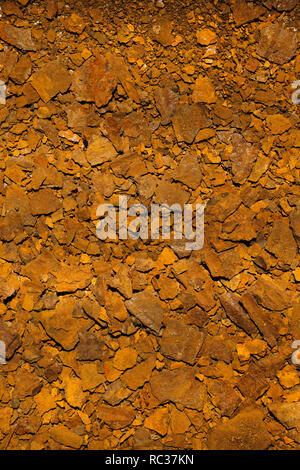 Flakes of dry rusted metal from corroded metal bucket. - Stock Photo