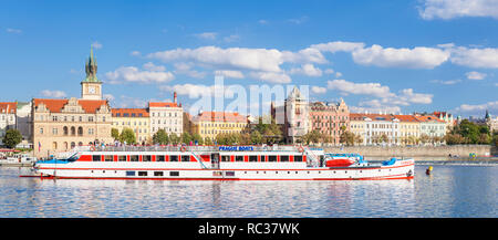 Prague Boats river cruise boat for sightseeing on the river Vltava going past the Bedrich Smetana Museum and Old Town Water Tower Prague Europe - Stock Photo