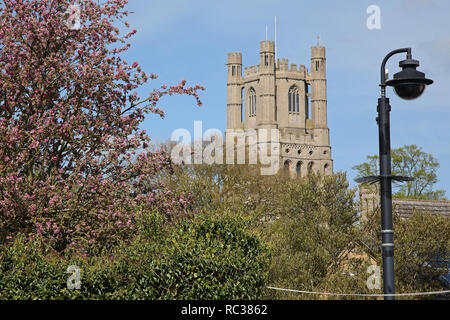 CCTV camera in Ely, Cambridgeshire, with the West Tower of the Anglican Cathedral on the skyline - Stock Photo