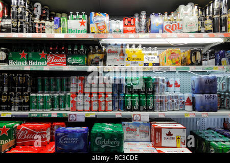 beer shelf in a supermarket - Stock Photo