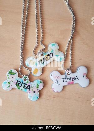 bone-shaped dog collars with names - Stock Photo