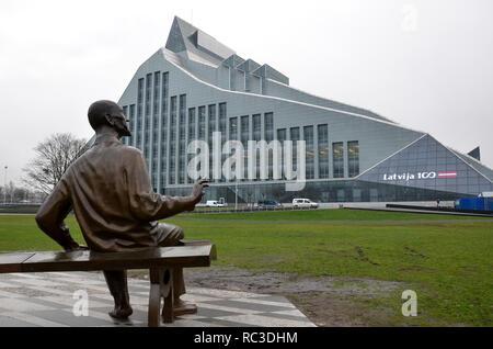 The National Library of Latvia and the statue of Latvian writer Rainis, Riga, Republic of Latvia, Baltics, December 2018 - Stock Photo