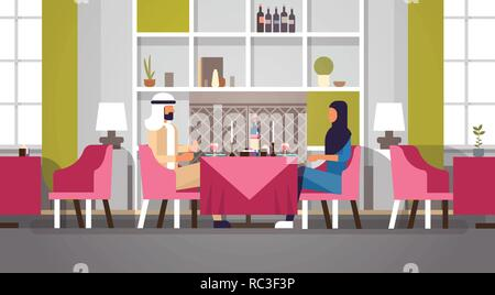 arabic couple sitting cafe table romantic dinner happy valentines day celebration concept arabic man woman love dating modern restaurant interior horizontal flat - Stock Photo