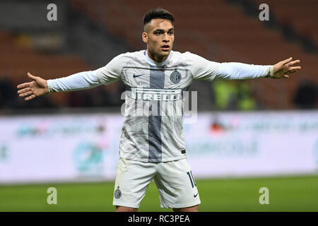 Milan, Italy. 13th Jan 2019. Forward Lautaro Martínez (Inter) gestures during the Italian Cup 'Coppa Italia' football match, Inter Milan vs Benevento Calcio at San Siro Meazza Stadium in Milan, Italy on 13 January 2019. The football match is played behind closed doors after Napoli's Senegalese player Kalidou Koulibaly was subject to racist chants by FC Internazionale's 'ultra' fans during the Boxing Day match. Credit: Piero Cruciatti/Alamy Live News - Stock Photo