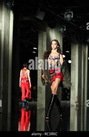 Milan, Italy. 13th Jan, 2019. Models present creations for Dsquared2 during Milan Men's Fashion Week in Milan, Italy, on Jan. 13, 2019. Credit: Cheng Tingting/Xinhua/Alamy Live News - Stock Photo