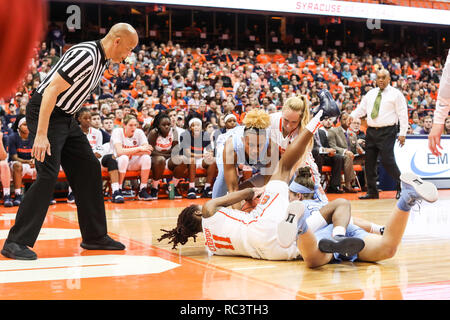 Syracuse, New York, USA. 13th Jan, 2019. January 13, 2019 : North Carolina's Paris Kea (22), Leah Church (20), Syracuse's Gabrielle Cooper (11) and Digna Strautmane (45) go for the loose ball while the offical observes to make a call during the NCAA basketball matchup between the Syracuse Orangewomen and University of North Carolina Lady Tar Heels at the Carrier Dome in Syracuse, New York. Syracuse defeated North Carolina 90-77. Nick Serrata/Eclipse Sportswire/CSM/Alamy Live News - Stock Photo