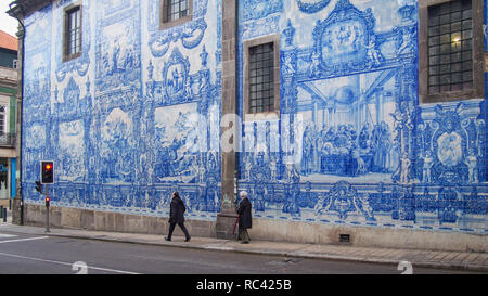 Pavement next to the wall of the Chapel of Souls (Capela das Almas), Porto, Portugal - Stock Photo