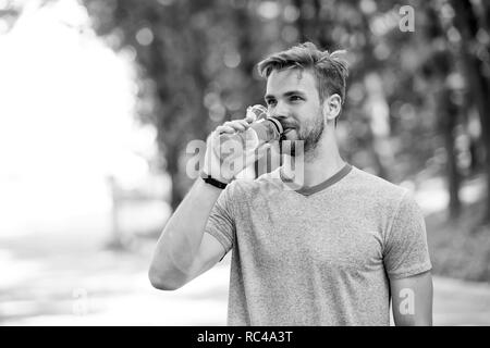 quench your thirst. man feel thirst. man drink water because of thirst. thirst feeling of man after workout - Stock Photo