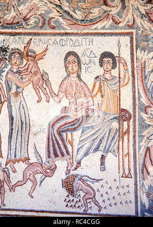 Ancient byzantine natural stone tile mosaics with with the image of the goddess Aphrodite, cupids, women, men and floral ornament, Madaba, Jordan - Stock Photo