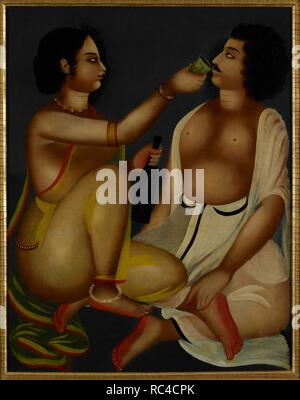 A woman offering a cup of wine to her lover. Two lovers are both seated on the green floor. She wears a yellow transparent sari and presses the cup to his lips with one hand while holding the bottle with the other. He wears a white dhoti and holds his head back to receive the wine. Both their heads are in profile; she has her eyes fixed on him but he raises his a little obviously enjoying the wine. Their boneless bodies are softly modelled in light but there is no consistent light source. The artist uses modelling with light in the traditional Kalighat way with various parts of the body highli - Stock Photo