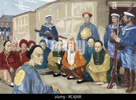 The Boxer Rebellion (1900). Boxer prisoners in a village in China guarded by German sailors. Engraving by Etching Gerlach. Colored. - Stock Photo