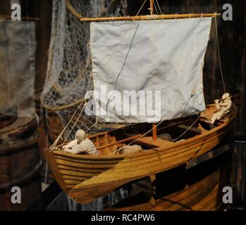 Model of a vessel of 15th century used to transport of goods in the Stockholm's archipelago. Oak. Made by C. Kruckeberg. Figures by A. Amberg. Medieval Museum. Stockholm. Sweden. - Stock Photo