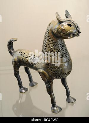 Incense-Burner in the shape of a Lynx. Bronze; casting, engraving, silver and copper inlay. Iran. 11th century. The State Hermitage Museum. Saint Petersburg. Russia. - Stock Photo