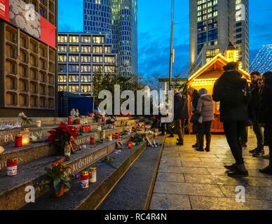 Berlin Breitscheidplatz memorial at Christmas Market, Berlin City Weihnachtsmarkt, for the12 victims of 2016 terror attack. Visitors lighting candles. - Stock Photo