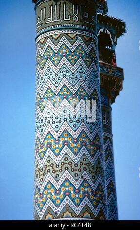 Iran. Qum.  ShiÕite sanctuary of Fatima al-Masumeh, the sister of Imam Reza. Minaret. Detail. Glazed ceramic. Safavid art. - Stock Photo