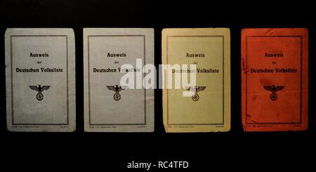 History of Nazism. Occupied Territories. Poland. The people registered in the Volksliste (List of the German people) received identity cards of different colors, depending on the group in which they are classified. Blue for the first and second group, green for the third and red for the fourth. - Stock Photo