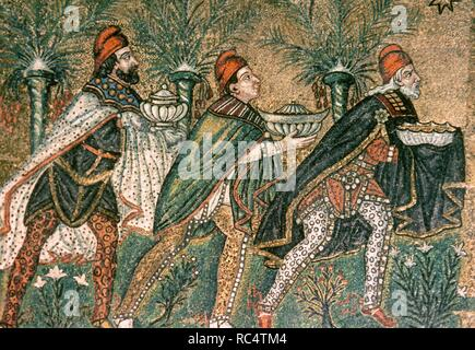 The Three Magi. Byzantine mosaic. Ca. 550. Detail. Restored in 18th century. Depicted in Persian clothing with breeches, capes, and Phrygian caps. Basilica of Sant' Apollinare Nuovo. Ravenna. Italy. - Stock Photo
