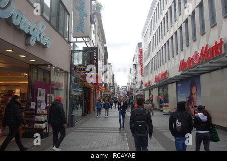 Shoppers on Hohe Straße, a major shopping street in the old town of Cologne, Germany, one of the cities busiest streets. - Stock Photo
