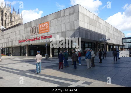 Tourists standing outside the Roman museum in Cologne, Western Germany. - Stock Photo