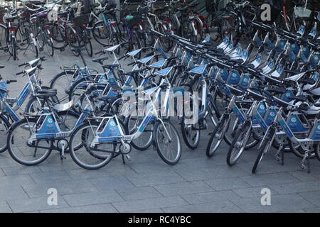 Bicycles for hire outside the main train station in Cologne, one of several bike hire schemes available in the city. - Stock Photo