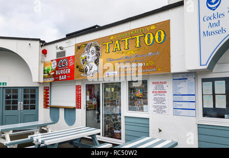 Body Images tattoo and body piercing studio for body art on South Parade Pier, Southsea, Portsmouth, south coast England, UK - Stock Photo
