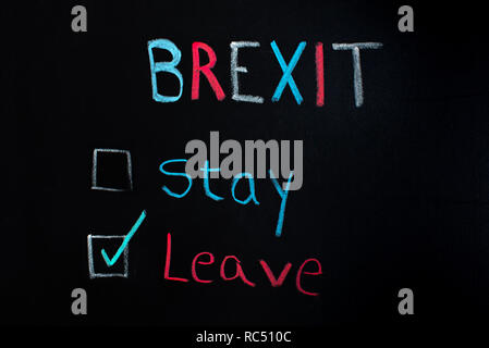 Brexit concept, choice between staying or leaving, written on blackboard. - Stock Photo