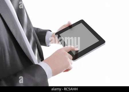 close up.businessman tapping the screen of the digital tablet - Stock Photo