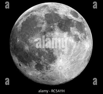 Big moon in its full phase with detailed craters visible on its edges, all in  a black background, taken with large newtonian telescope. - Stock Photo