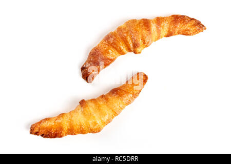Two croissants on a white background, shot from the top, with a place for text - Stock Photo